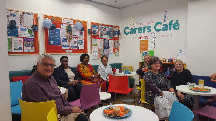 group of carers in carers cafe smiling