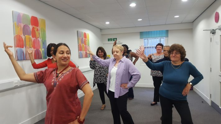 group of carers dancing Bollywood moves