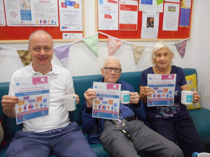 Carers holding up posters
