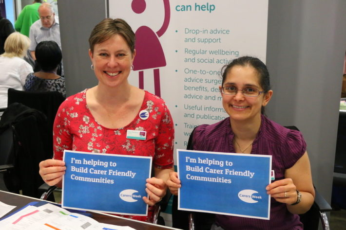 Helen and Victoria holding up Carers Week pledges